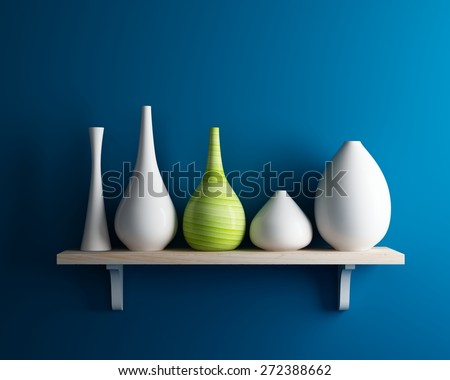 vase on shelf with blue wall interior - stock photo