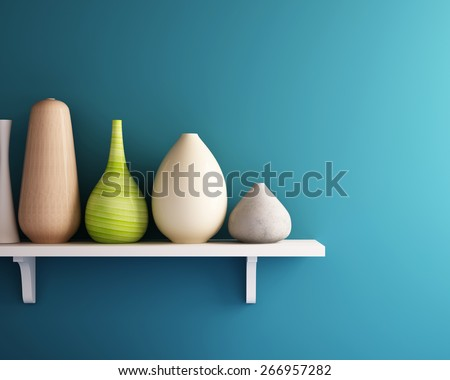 vase on white shelf with blue wall - stock photo