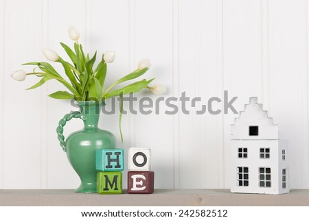 Vase white tulips and decoration at home - stock photo