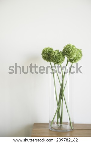 Vase with flowers on the table  - stock photo