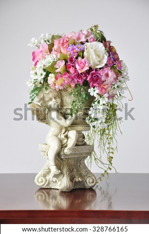 Vases artificial flowers lovely angel cupid stock photo royalty vases artificial flowers lovely angel cupid flower vase ornament mightylinksfo