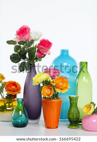 Vases with flowers on a white background - stock photo