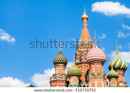 Vasily the Blessed cathedral on Red Square in Moscow and blue sky with white clouds in sunny summer day - stock photo
