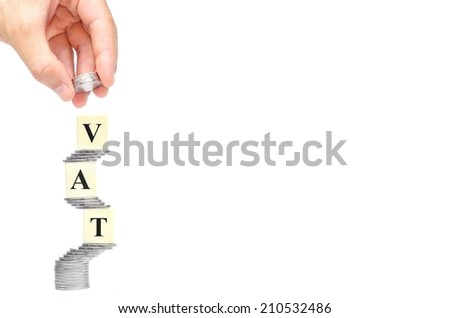 VAT (Value Added Tax) on Stacks of silver Coins with isolated background - stock photo