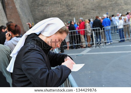 VATICAN - APR 29:Catholic nun outside the Vatican Museums on April 29 2011 in Rome Italy.It's includes some of most classical sculptures and important masterpieces of Renaissance art in the world. - stock photo