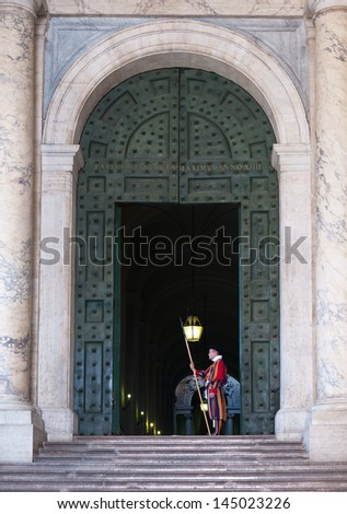 VATICAN CITY - CIRCA SEPTEMBER 2011: a soldier of the Swiss Guard stands at the entrance to the Apostolic Palace circa september 2011 in Vatican City. The Pontifical Swiss Guard was founded in 1506.
