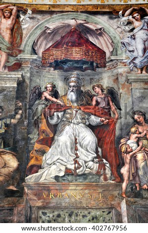 VATICAN CITY, ITALY - MARCH 14, 2016: The paintings on the walls and the ceiling of the Vatican were painted in the Renaissance and are visited in the modern times by crowds of people - stock photo