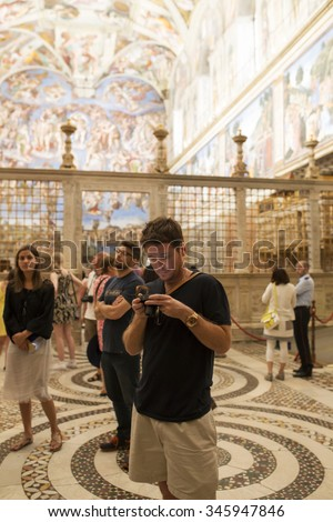 VATICAN CITY, VATICAN, JULY 18, 2015 . Kevin Connolly and Jerry Ferrara admiring the magnificent Universal Judgement inside the Sistine Chapel . VATICAN MUSEUM 18 JULY. - stock photo