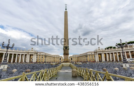 Vatican City, Vatican - September 28, 2015: Tourists at Saint Peter's Square in Vatican City, Vatican. Saint Peter's Square is among most popular pilgrimage sites for Roman Catholics. - stock photo