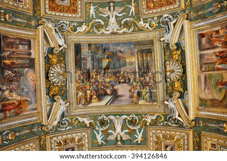 VATICAN, ITALY - MARCH 14, 2016: The carved, ornated and painted ceiling of the Gallery of Maps in the Vatican Museum is visited daily by crowds of people - stock photo