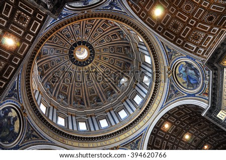 VATICAN, ITALY - MARCH 16, 2016: The ceiling of the Saint Peter basilica was painted over decades and is visited daily by thousands of tourists and religious people