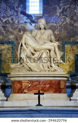 VATICAN, ITALY - MARCH 16, 2016: The famous sculpture of Pieta in the Saint Peter basilica was made by Michelangelo and is visited daily by thousands of tourists - stock photo