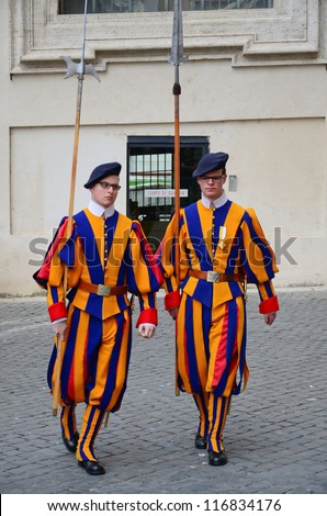 VATICAN - MARCH 26: Famous Swiss Guard on March 26, 2012 in Vatican. The Papal Guard with 110 men probably is the world's smallest army.