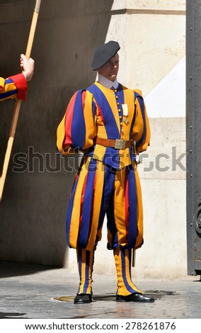 VATICAN - MAY 07: Members of the Pontifical Swiss Guard stand guard in Saint Peters Basilica in Vatican on May 07. 2015 in Italy.
