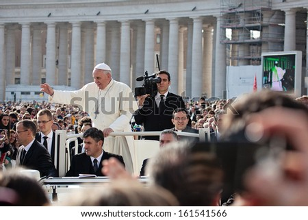 VATICAN - October 30: Pope Francis I on the popemobile blesses the faithful crowd in St. Peter's Square in Vatican on October 30, 2013. - stock photo