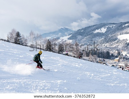 VATRA DORNEI, ROMANIA - FEBRUARY 2016: A kid skiing at a ski slope