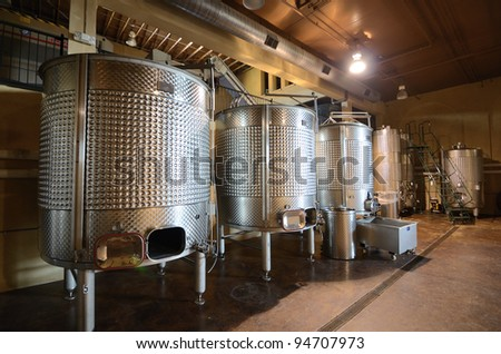 Vats in a cellar wine distillery. - stock photo