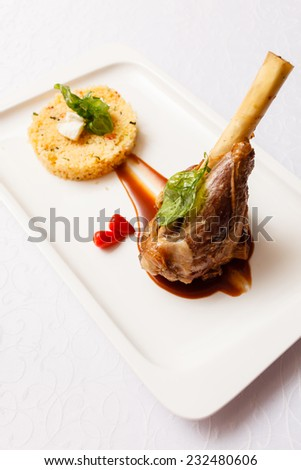 Veal chop with rice - stock photo