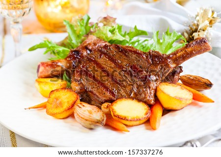 Veal chop with vegetables for Christmas dinner - stock photo