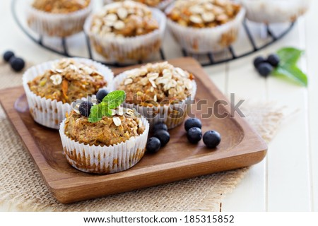 Vegan banana carrot muffins with oats and berries - stock photo