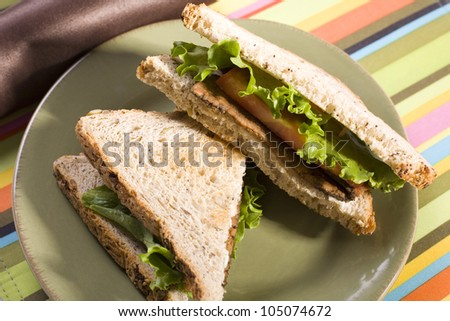 Vegan BLT - Tempeh Lettuce and Tomato Sandwich with Smoky Flavored Tempeh on Toasted Whole Grain Bread