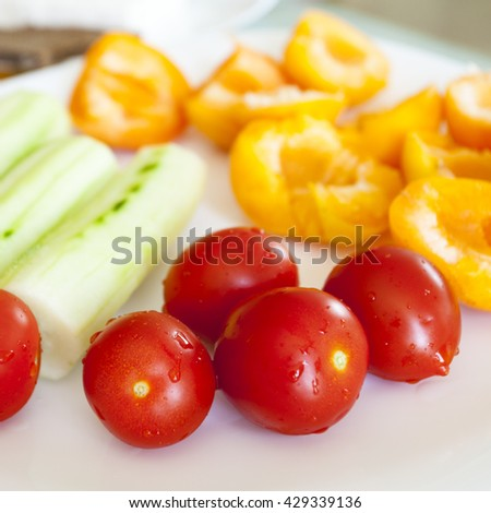 Vegan breakfast. Cucumbers cherry tomatoes and apricots