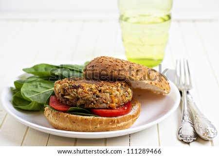 Vegan burger with spinach (made with beans and vegetables) - stock photo