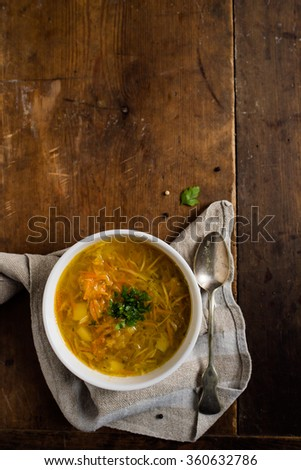 Vegan cabbage soup on a brown, vintage table - stock photo