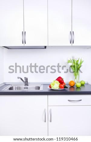 Vegan food in white kitchen interior - stock photo