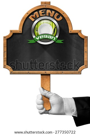 Vegan Menu  / Hand of waiter with white glove holding a pole with empty blackboard, vegan symbol with empty white plate and silver cutlery. Isolated on white background - stock photo