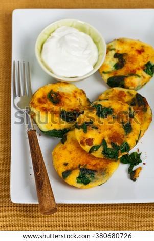 Vegan Potato and Spinach Cheddar Cakes. Selective focus. - stock photo