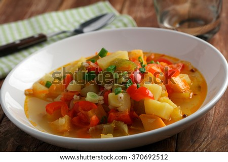 Vegan soup on a rustic table - stock photo