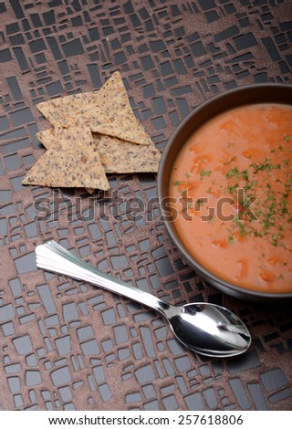 vegan tomato soup and chips in winter - stock photo