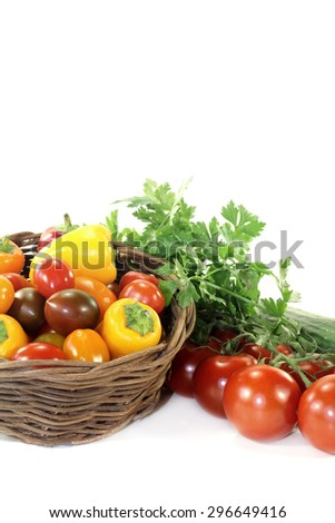 Vegetable basket with mixed vegetables on a light background - stock photo