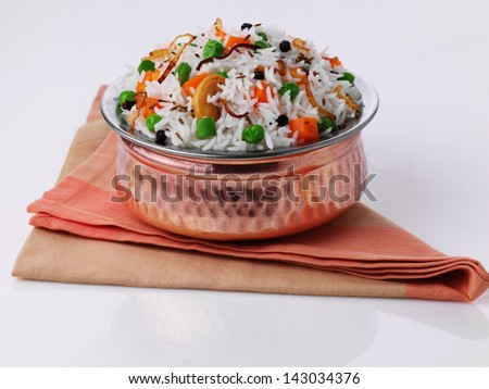 vegetable biryani in handi - stock photo
