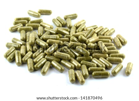 vegetable capsule on white background