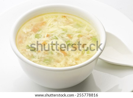 Vegetable Clear Soup with Eggs - stock photo