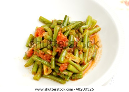Vegetable food with green beans, tomatoes and garlic. horizontal view - stock photo