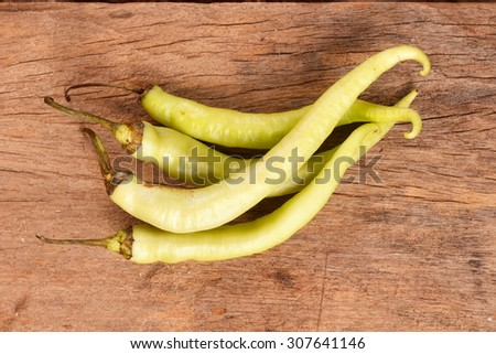 Vegetable, Green Hot Chili or Chilli Cayenne Pepper on Wooden - stock photo