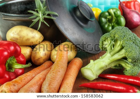 Vegetable ingredients with cast iron pan on table - stock photo