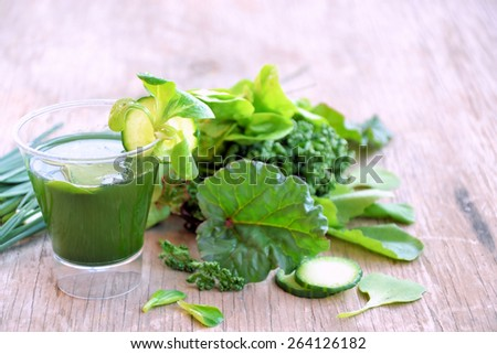 vegetable juice and green vegetables - stock photo