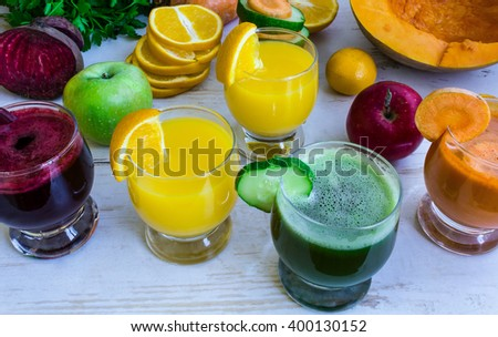 Vegetable juice, fruit fresh juice. Pumpkin fresh juice, beet juice, cucumber juice. Orange fresh juice. Vegetables and fruit on the table - stock photo
