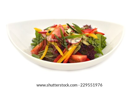 Vegetable mix, appetizer. Delicious vegetarian salad (pepper, tomato, cucumber, lettuce) served in white plate, isolated on white - stock photo