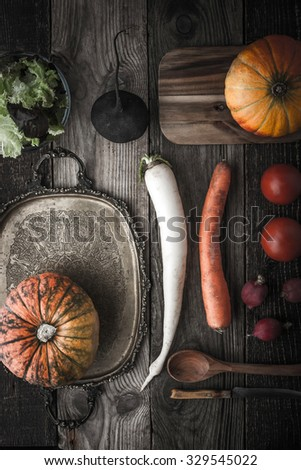 Vegetable mix with vintage tray and kitchenware with film filter effect - stock photo