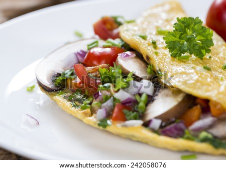 Vegetable Omelette (close-up shot) with fresh mushrooms and herbs - stock photo