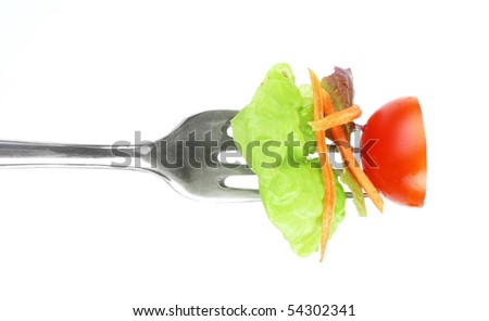 vegetable on fork isolated on white - stock photo
