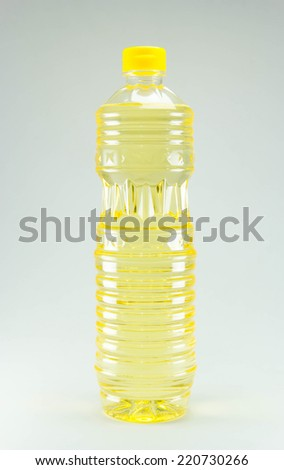 vegetable or sunflower oil in plastic bottle isolated with clipping path included. - stock photo