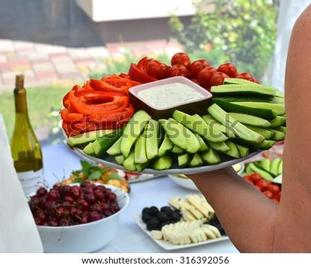 vegetable platter on hand - stock photo