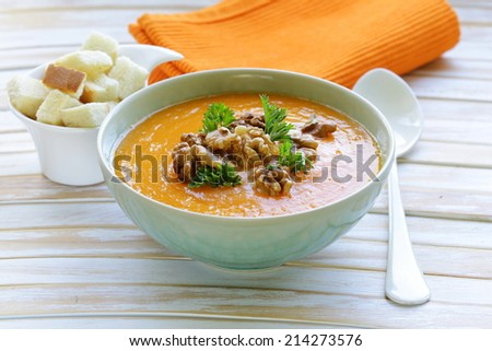 vegetable pumpkin cream soup with walnuts and parsley  - stock photo