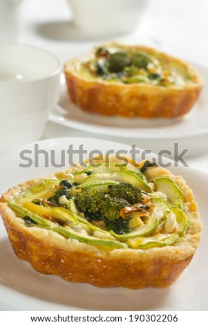 Vegetable quiche with zucchini, spinach, feta cheese, broccoli. - stock photo